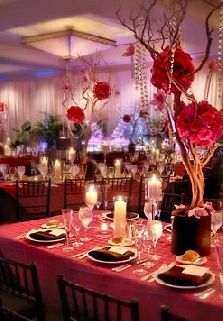 Romantic with dim lighting, red florals, branches & crystals