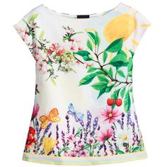 Girls pretty garden scene blouse by Love Made Love, made with a silky fabric and smooth cotton lining. With very short sleeves, it has a stunning print on the front featuring pretty flowers, butterflies and cherries. The contrasting back has a black and white polka dot print and it has pastel stripes around the hem.  Model: Height 122cm (average 7 years) Size of blouse shown in the photo: 6-7 years