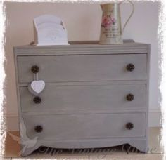 A beautiful 1940's vintage walnut chest of drawers painted in Annie Sloan Old White with a top coat of Paris Grey. The drawers have been lined with a stunning Laura Ashley Josette wallpaper in dove grey. The cabinet has been hand painted in old white with paris grey on top and lightly distressed to enhance the features of the piece and add definition. It has then been waxed for protection.
