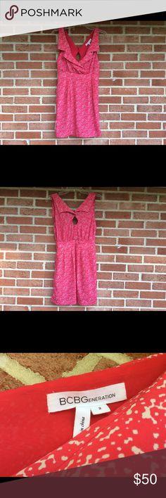 BCBGeneratin Dress sz2 Red and white sleeveless crisscross V-neck caller buns in the back of the neck has two pockets in the front #1072 BCBGeneration Dresses