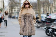 Olivia Palermo is wearing a beige fur coat navy ripped jeans outside Ellery during the Paris Fashion Week Womenswear Fall/Winter 2016/2017 on March 8, 2016 in Paris, France.