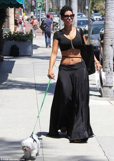 Just the two of us: Nicole Murphy was spotted putting on quite the sexy display while walking her precious pooch in Beverly Hills on Monday
