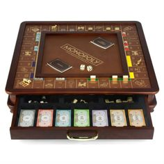 Luxury Monopoly   |   This high-quality luxury edition of the classic Monopoly game is set in a footed two-toned wooden cabinet with a burled wood veneer, and has built-in storage drawers. The gold-foil detailed game board also features a rich faux-leather center dice-rolling area. All tokens, houses and hotels are made of die-cast metal and easily store in a built-in drawer. A second drawer serves as a pull-out banker's tray.   |   Only $199!!!