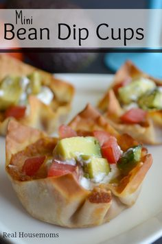 Mini Bean Dip Cups Recipe ~ These mini bean dip cups are the perfect appetizer for parties. They are delicious and an individual serving of beans, salsa, cheese and sour cream in a wonton!
