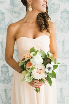 peach and green bouquet - photo by Ashley Caroline http://ruffledblog.com/garden-inspired-wedding-at-brooklyn-winery #weddingbouquet #flowers #bouquets