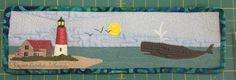 Row by Row Experience, Massachusetts: Cape Cod  Islands. For 2014 this is the Quilt-ish panel. Show here is a mini version of the large panel that is meant to be a full row that's 9 x 36.5 inches. It depicts the Nauset Light and one of the area's impressive humback whales. Get your free pattern and kit ONLY at the studio shop's physical location. Contest rules prohibit online sales until after the contest is over. Online sales start in Sept.  See board description for location, hours