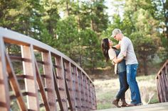 There are beautiful walkways and a bridge at the Evergreen Lake House in Colorado. It is the perfect location for Engagement Photos or couples pictures. If you are looking for a very Colorado-esque location, this is the one! Photography by artistic team - From the Hip Photo based in Denver Colorado.