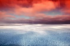 Colorful sky over icy Hudson Bay, Canada.