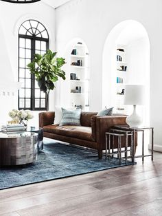 Coco Republic , luxe interiors , feature window , leather couch , vintage inspired interiors , mid century furnishings , round archway