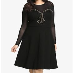 Torrid size 4 studded LBD Sheer mesh long sleeves give covered but sexy little black dress appeal on this skater style dress. Matching heels available for purchase. Size 4 torrid is equal to a 26/28 torrid Dresses Long Sleeve