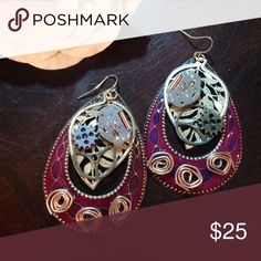Steampunk earrings Beautiful purple and maroon steampunk earrings. These are made with their own personality, so they are not identical. They are fun and quirky and will accent your perfect outfit. Jewelry Earrings