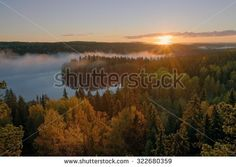 Stock Photo: Foggy morning inf the Aulanko nature reserve park in Finland. The sun hits the fog above the lake in the early morning. HDR image.
