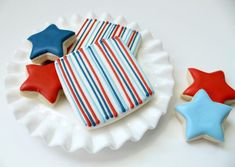 Red White and Blue Cookies. Not sure I could pipe such straight lines, though!