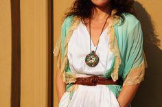 ACG's lead fashion stylist, Hanna Garner in an antique silk gossamer peignoir, Badgley Mischka white silk jumpsuit, Twelfth St. by Cynthia Vincent belt, beaded flask necklace.