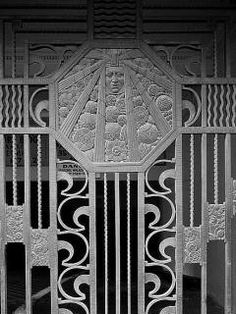 A photo from the Library of Congress's collection.  A gate at the WP Story building in LA