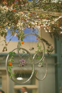 hanging centerpiece at the reception. Not sure I want to go as far as bicycle wheels but it instantly made me sing the wicked witch song as she flies around on her bike. Bicycle Party, Bicycle Rims, Hanging Centerpiece, Centerpieces, Jardin Decor, Burgundy And Blush Wedding, Renaissance Wedding, Wicked Witch, Saint Valentine