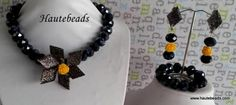 Beautiful black crystals Yellow flower and grey highlights Earrings and bracelets included  