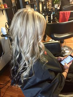 Platinum blonde with lowlights and dark brown underneath. Beautiful Clip In Hair Extensions 100% virgin remy human hair. http://www.belacahair.com/clip-in-hair-extensions.html Email: belacahair@yahoo.com Skype: belaca-hair WhatsApp: 008613247531950