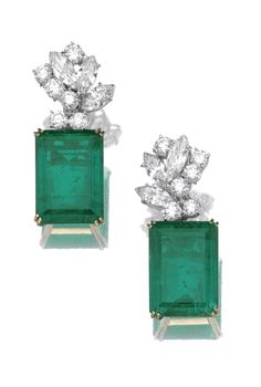 Pair of emerald and diamond ear clips Each set with a detachable step-cut emerald weighing 35.53 and 36.03 carats respectively, suspended from a cluster surmount of marquise-shaped and brilliant-cut diamonds, mounted in gold, clip fittings.