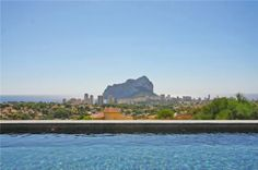Relax in the pool and enjoy the sea view of the coast of Calpe in Spain