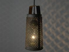 Repurposed Antique Cheese Grater Pendant Light Fixture  Visit Sleepy Poet Antique Mall to Find everything you need to re-create this look!