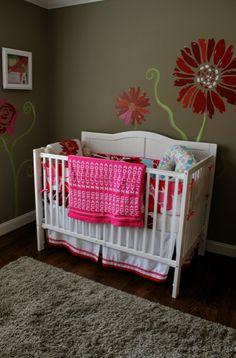 my niece's nursery... check out the names in knit blanket and adorable mural! see my blog for more photos