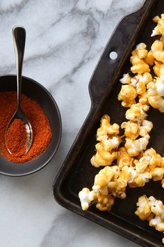 NYT Cooking: Sweet, sticky caramel popcorn gets a kick of cayenne pepper and the combination is nonpareil. Once the caramel is poured over the popcorn, work quickly and let it cool a bit before serving. The snack is easy to make, and running out will likely be a problem -- so have extra supplies on hand.