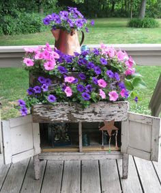 Here's a cute upcycle for an old sideboard -- pretty planter!