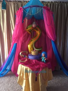 Shimmer and Shine Cake table decoration .