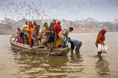 Many of the pilgrims who travel to Varanasi to bath in the Ganga choose to cross the river to bath in the cleaner water. This group of pilgrims had just arrived and were going ashore to prepare for one of the most important moments in their spiritual life.