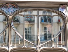 Nouveau window designs give artistic touch to this architecture.
