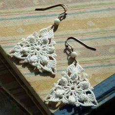 Triangle Kenwood Crochet Earrings- White. $35.00, via Etsy. (I know how much hard work goes into pinning down each & every bit to stiffen these types of items.)