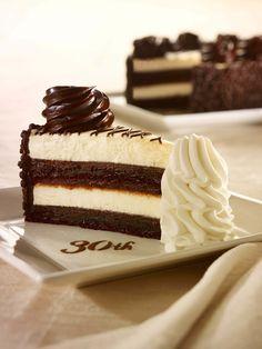 30th Anniversary Chocolate Cake Cheesecake: Layers of our Original Cheesecake, decadent fudge cake and chocolate truffle cream.