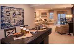 Finished lower level recreation room with bar; The Alistair floor plan, Drees Homes, Cleveland