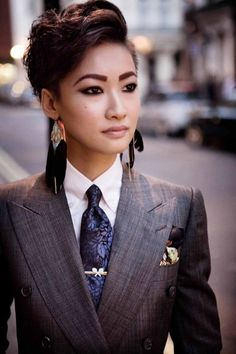 Esther Quek. The heavy jewelry pushes the boundaries of my internal criteria for this board, but I should get over that, right? It's a beautiful suit worn well.