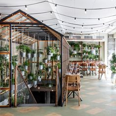 The majority of this Nordic restaurant in Copenhagen is housed within an indoor greenhouse that Danish design studio Genbyg created using recycled materials