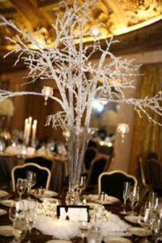 A winter wedding can be made into a very beautiful and magical event by incorporating some winter wonderland wedding ideas. Branch Centerpieces, Winter Wedding Centerpieces, Crystal Centerpieces, Wedding Table, Centerpiece Ideas, Tall Centerpiece, Tall Vases, Flowerless Centerpieces, Wedding Reception