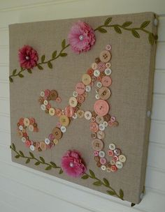 sweet button initial - but I want to do a word - for the craft room? Sew, create, dream, etc. - LOVE the look of this though. Perfect on burlap. Would make a nice gift with someone's initial too. #Crafts #Canvas #Buttons #HandmadeGifts #Monogram #WordArt