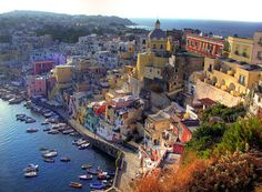 Procida Island, off the coast of Naples in Italy Places Around The World, Oh The Places You'll Go, Cool Places To Visit, Around The Worlds, Italy Tourist Attractions, Amsterdam, Places In Italy, Just Dream, Visit Italy