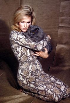 Ursula Andress, 1965 in snake skin print 'What's New Pussycat?'                                                                                                                                                     More
