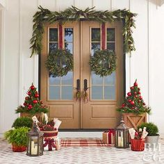This winter front door display is layered with holiday cheer. See how you can personalize your home's entrance with holiday front door decorations, including evergreen wreaths, garlands, pinecones, and pops of plaid.