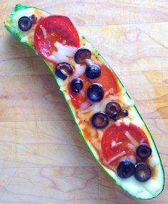 tomato or pizza sauce into zucchini boat. Top with shredded mozzarella ...