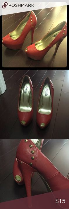 Red platform high heels Size 5 1/2 red platform shoes with gold detailing. There are small scuffs as shown in the picture, but otherwise in great condition. Charlotte Russe Shoes Heels