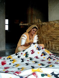 Rural artisan is traditional embroidering patchwork. Badmer, Rajasthan