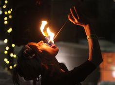 Holly Holman swallows fire while performing at the EVE celebration in Salt Lake City. (Rick Egan  | The Salt Lake Tribune)