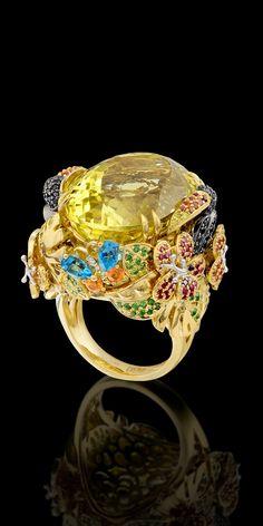Birds of Paradise Collection. Ring of gold, lemon quartz, diamonds of white, black, yellow and purple, colored sapphires, rubies, tsavorites, demantoids, topaz.