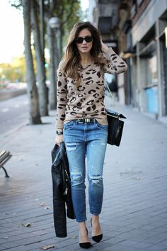 How to style a leopard jumper: with boyfriend jeans, a black leather jacket, black bag, shoes and belt