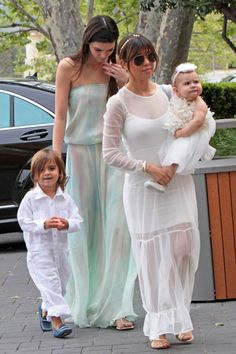 In color coordinated outfits, Kourtney Kardashian and her kids Mason and Penelope Disick joined Kris and Bruce Jenner along with daughters K...