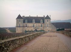The famous Burgundy vineyards in France. Cote De Nuits vineyards and Clos de Vougeot Castle and vines.