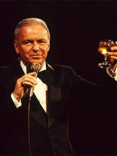 Raise a glass to Frank Sinatra! Even as he aged, Sinatra still enjoyed performing onstage. He is pictured here in 1975 toasting the audience during one of his shows in the UK. Music Icon, My Music, Peter Lawford, Jazz, Dean Martin, Star Wars, Before Us, Old Hollywood, Hollywood Stars